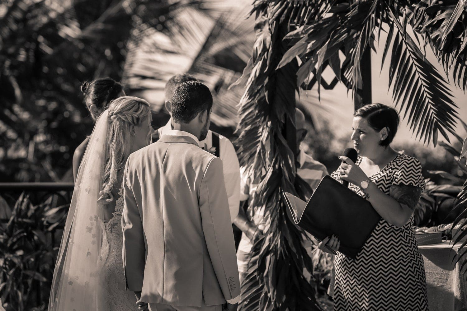 Officiant completes wedding ceremony at Villa Avalon in Puntarenas.