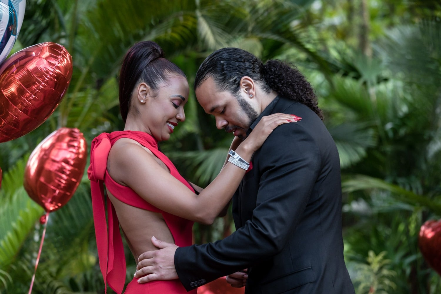 Couple shares an intimate moment after getting engaged at Tabacon Resort.