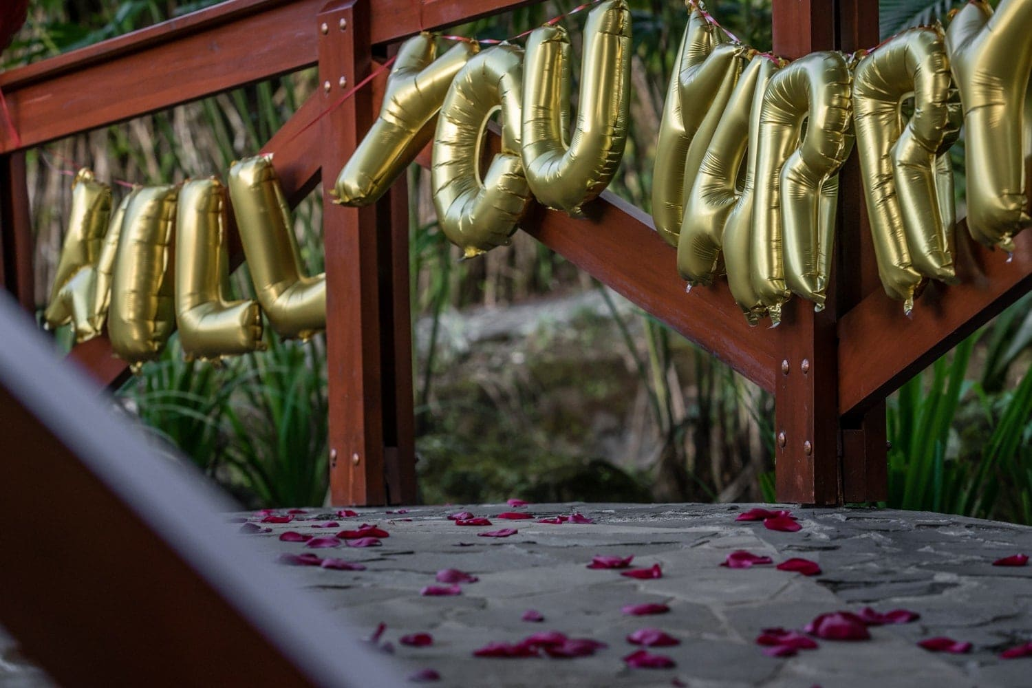 Decorations and flower petals on bridge for dream Costa Rica engagement