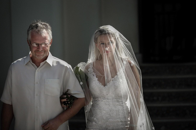 Father walks bride to altar on terrace at villa in Costa Rica.