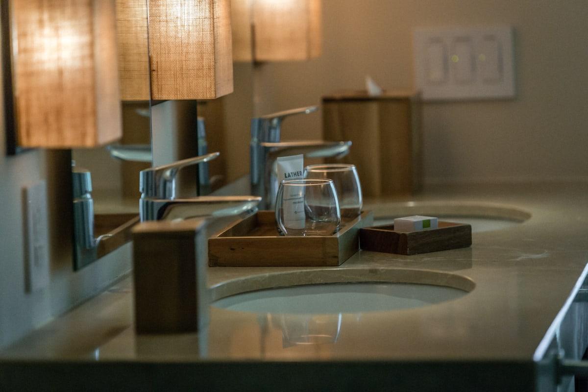 Dual sinks with stone countertop in Andaz Resort honeymoon suite.