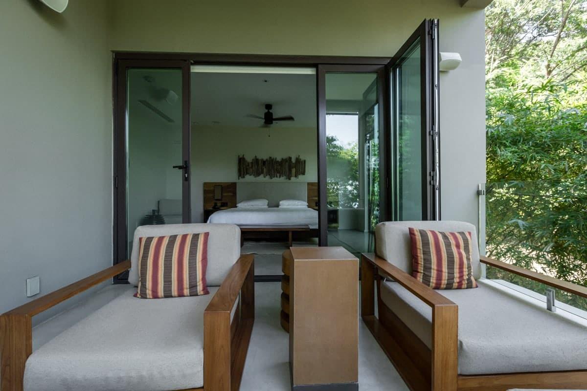 Andaz Resort's honeymoon suite with bedroom and balcony.