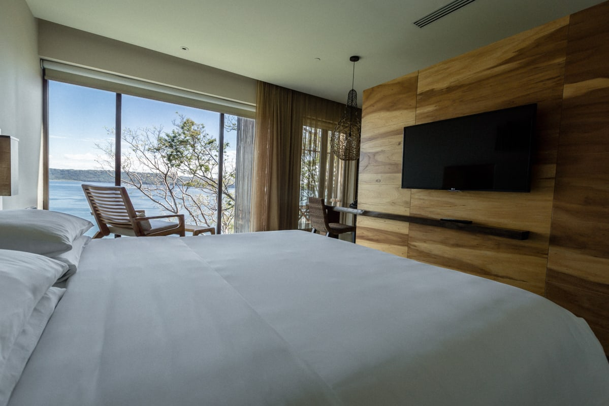 Ocean and rainforest view from bed in Andaz Resort's standard room.