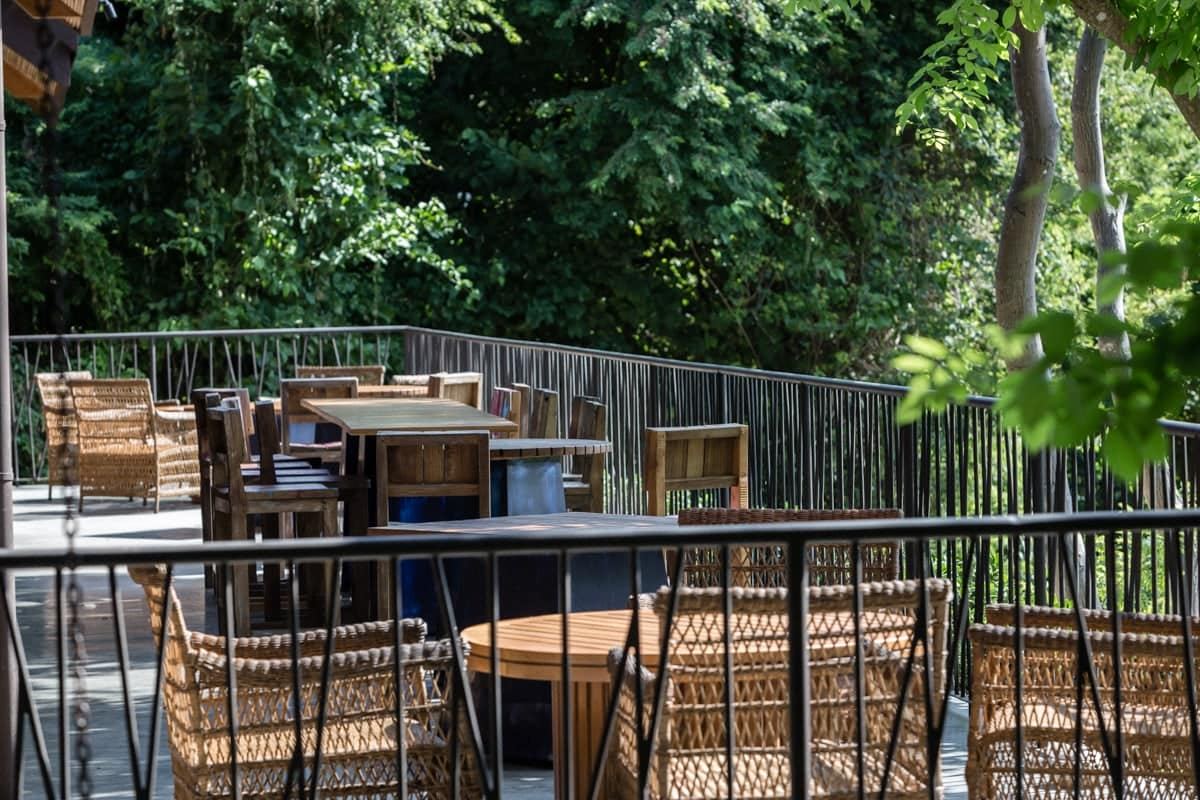 Outside seating area surrounded by rainforest for wedding receptions at Andaz.