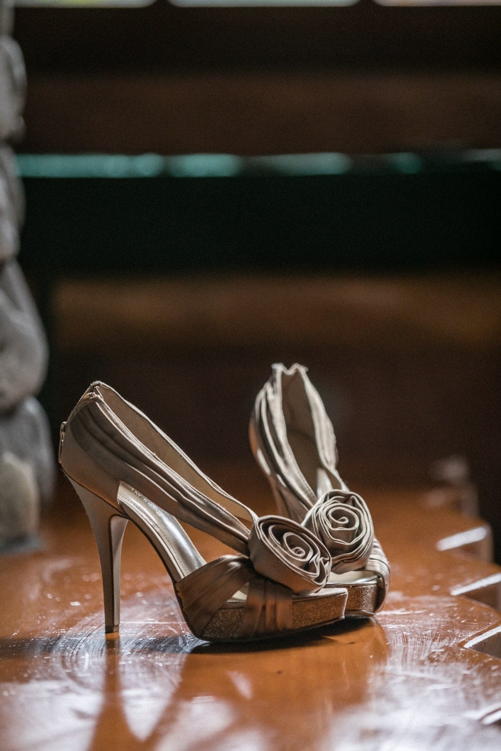 Bride's wedding day shoes in front of fireplace La Paz Waterfall Gardens honeymoon suite.