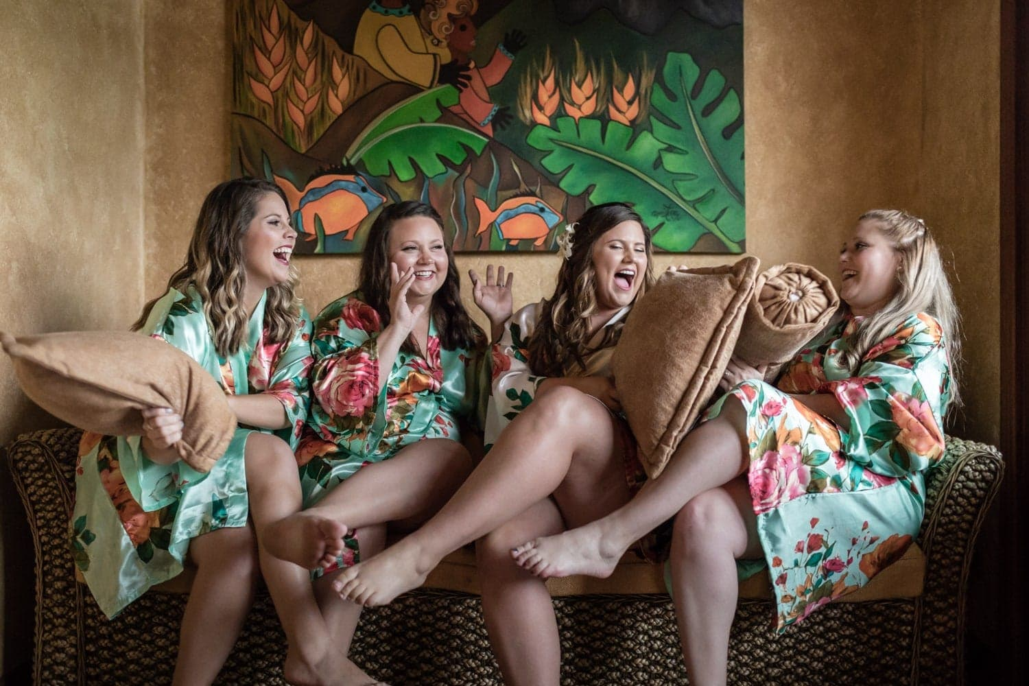 Bride and bridesmaids having fun while getting ready for wedding ceremony.