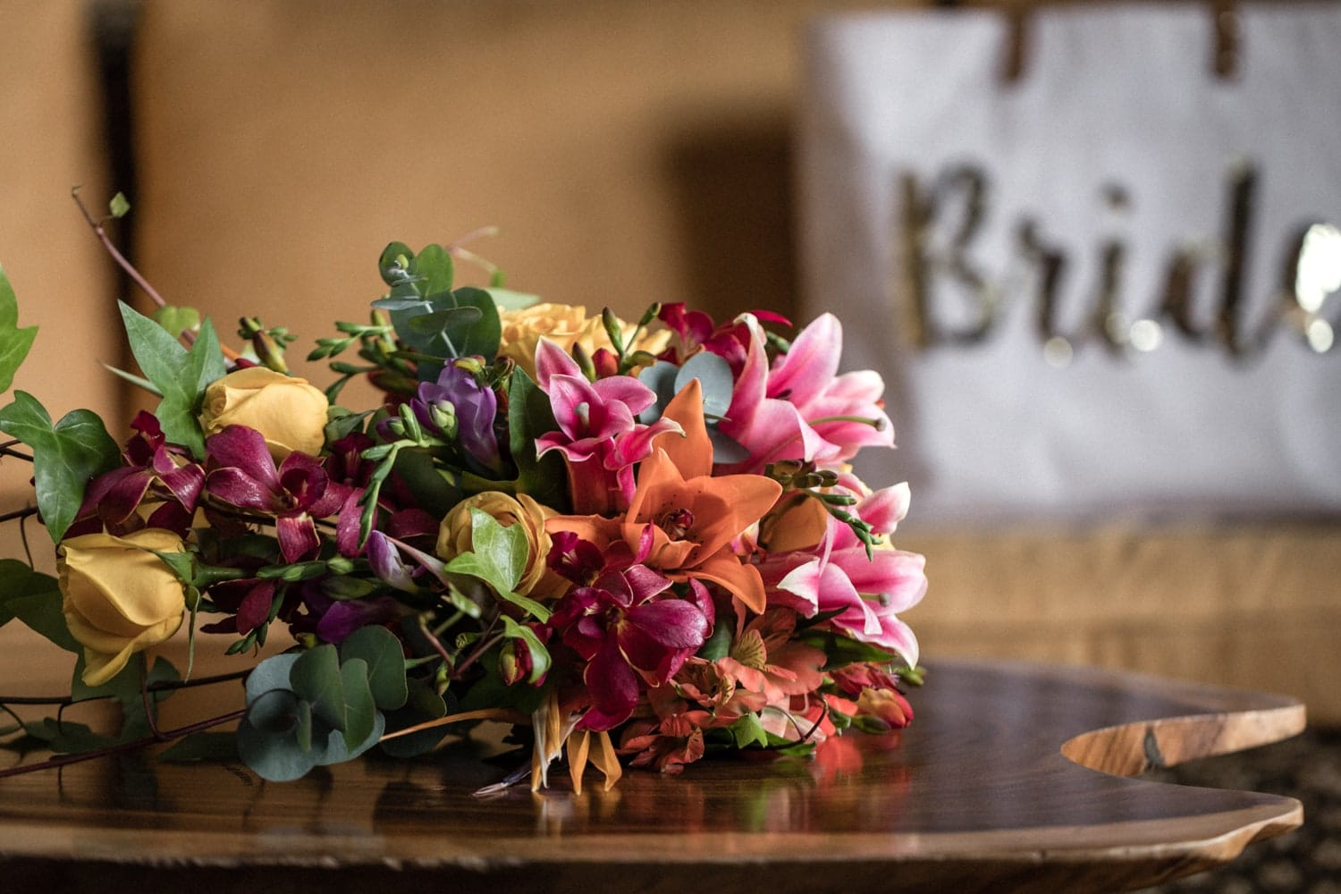 Bridal bouquet of tropical flowers on table at La Paz Waterfall Gardens.
