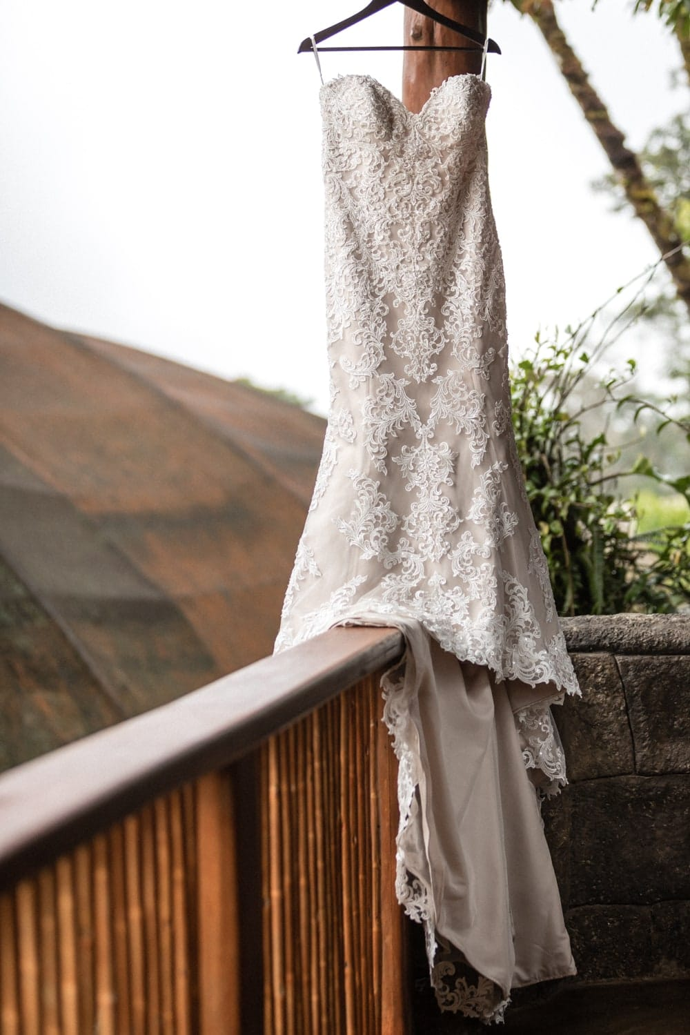 Gorgeous wedding dress on balcony at Peace Lodge in Costa Rica.