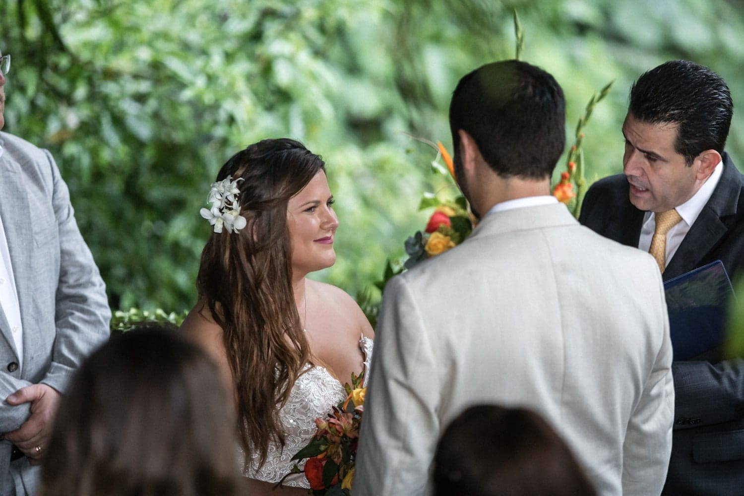 Bride and groom say vows at venue in cloud forest in Costa Rica.
