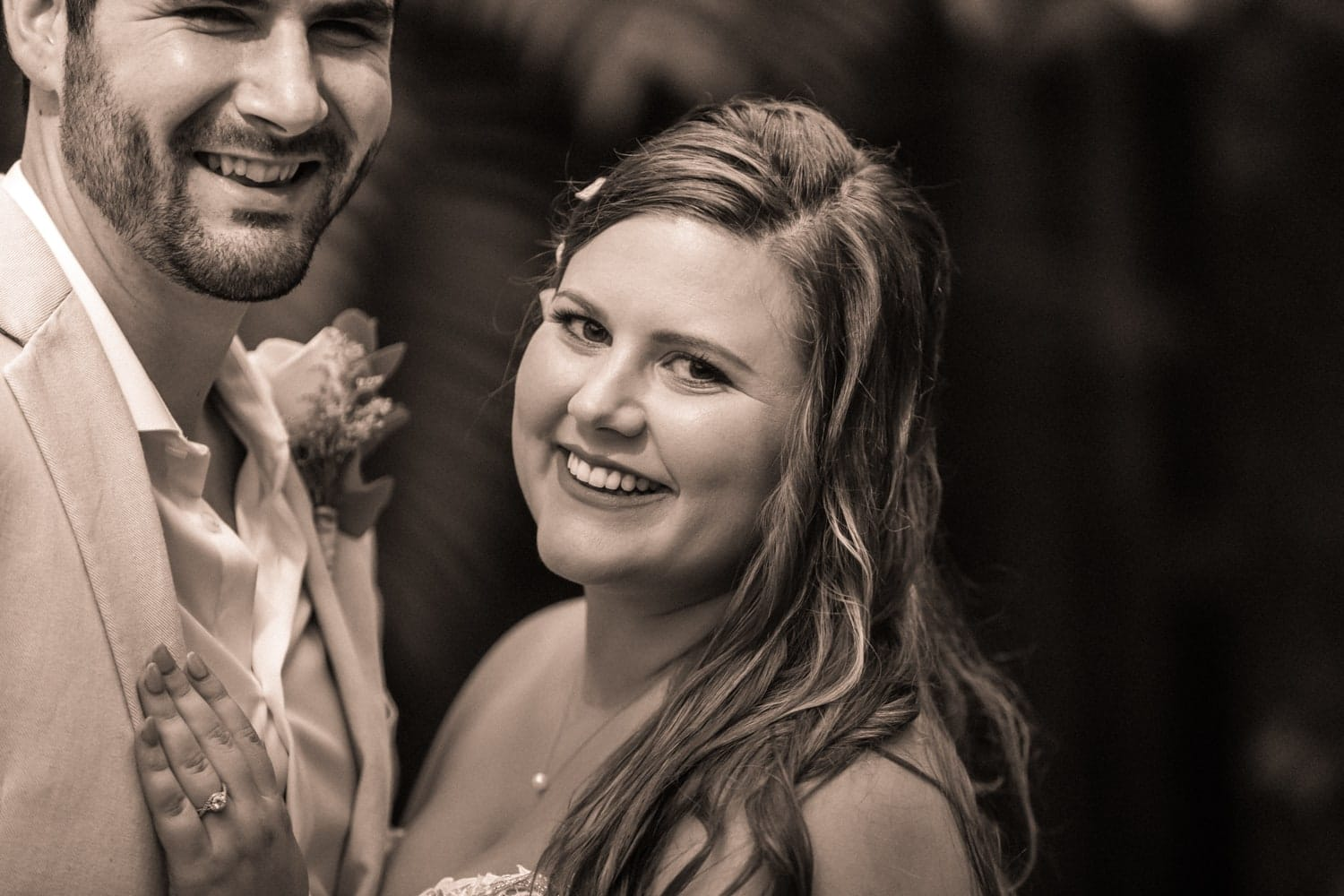 Soon-to-be-married couple smiles for picture before wedding ceremony in Costa Rica.