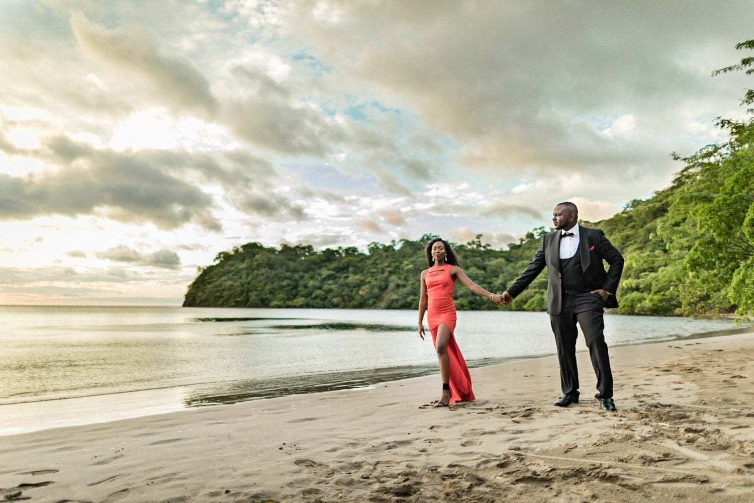 Just engaged couple on beach at sunset in Costa Rica.