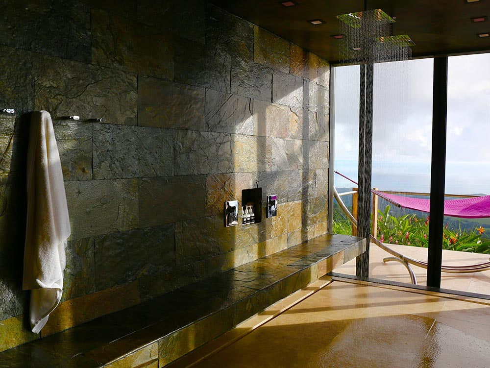 Kura Indoor-outdoor shower in honeymoon suite wit ocean views.