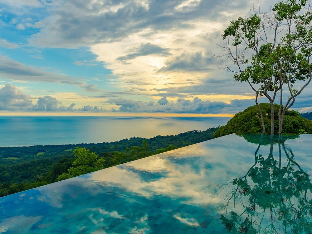 View of ocean and mountainous rainforest from Kura's infinity pool.