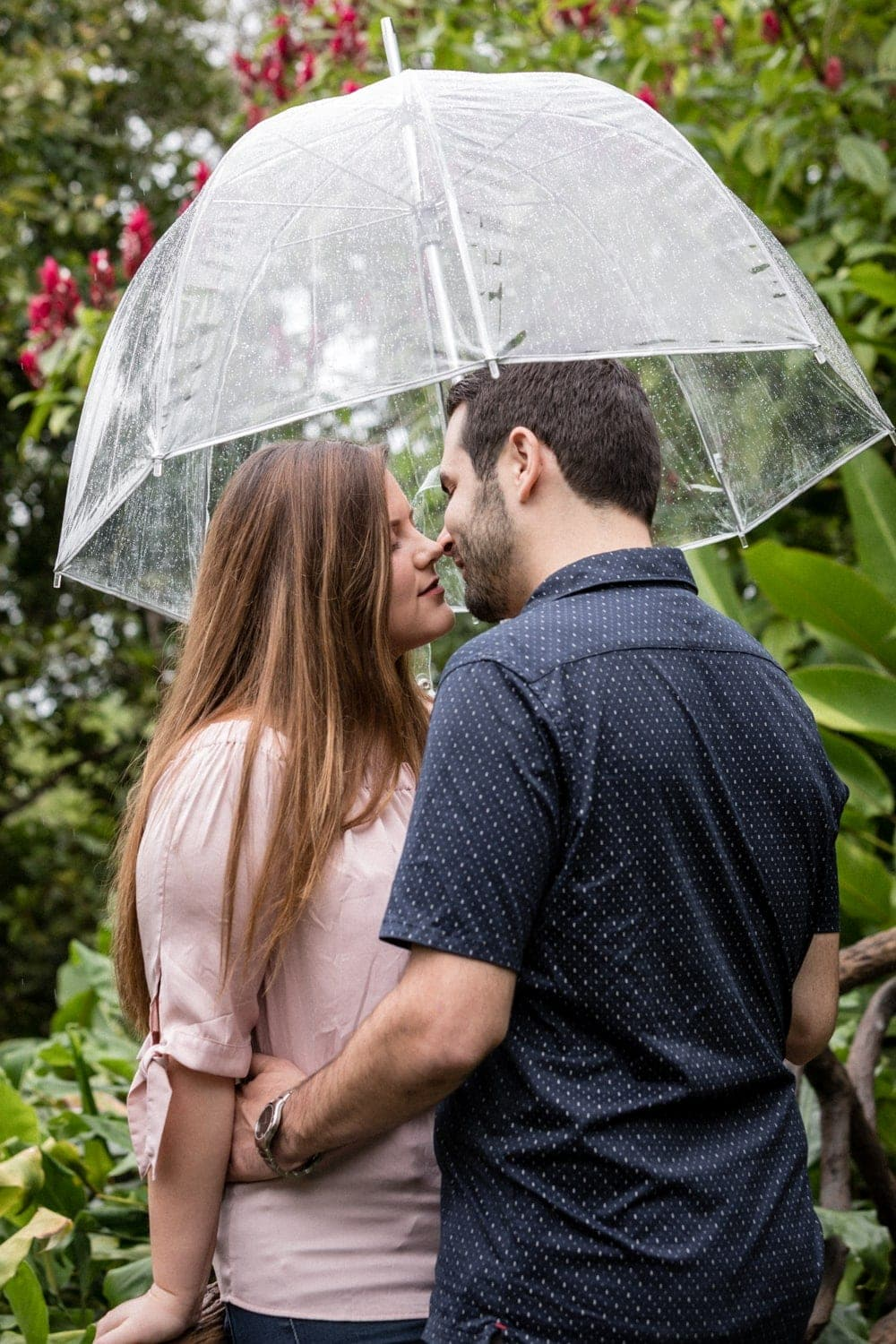 Couple in love about to kiss at La Paz Waterfall Gardens, Costa Rica.