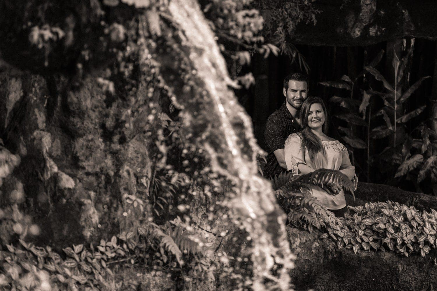 A La Paz Waterfall Gardens engagement photo of couple in love.