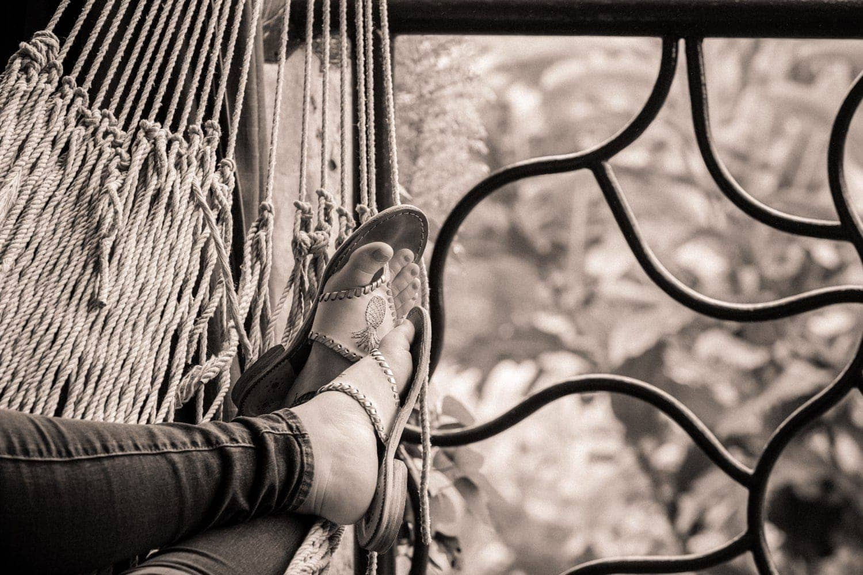 Fiancée in hammock on balcony in cloud forest at La Paz Waterfall Gardens.