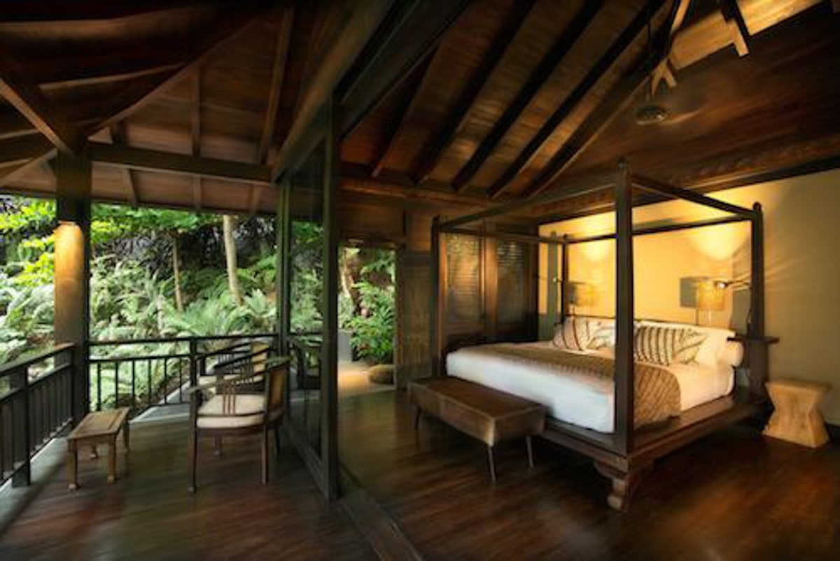 Rainforest views from romantic bedroom for wedding guests at El Chante Bungalows.