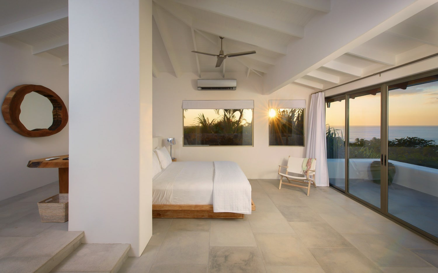 Luxury master suite with ocean view for couples on their wedding night.