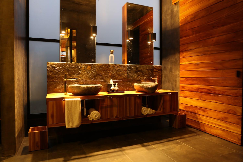 Luxury bathroom in Kura Hotel's master suite.