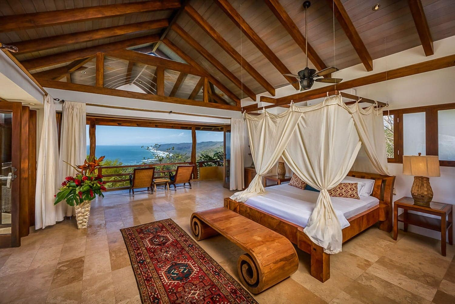 Great room for honeymoon suite with canopy bed and ocean views at Villa Nimbu.