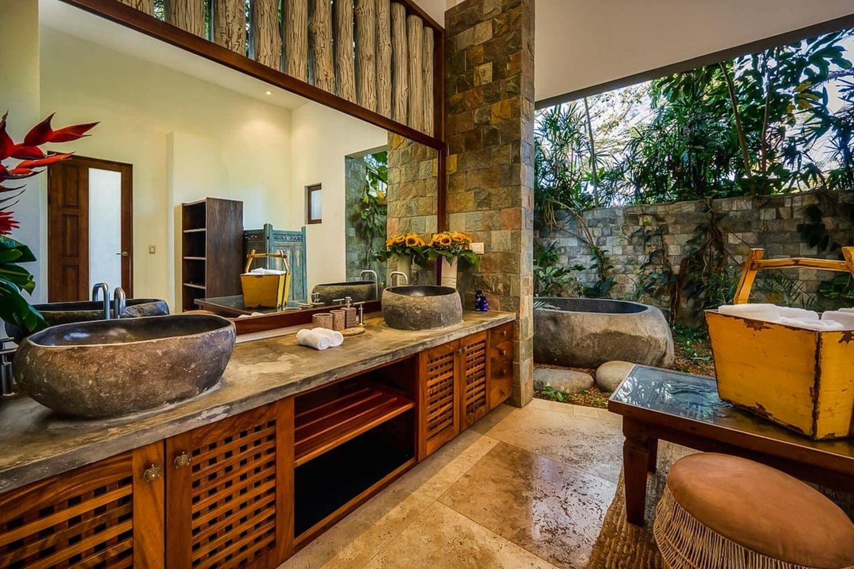 Gorgeous bathroom and outdoor bath for newlyweds at Villa Nimbu.