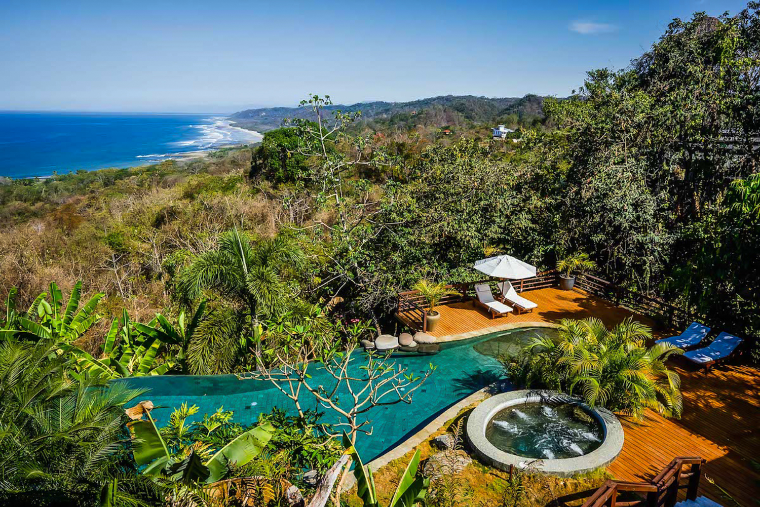 The pool at Villa Numa at Ocio Villas with stunning views of the Pacific Ocean and rainforest.
