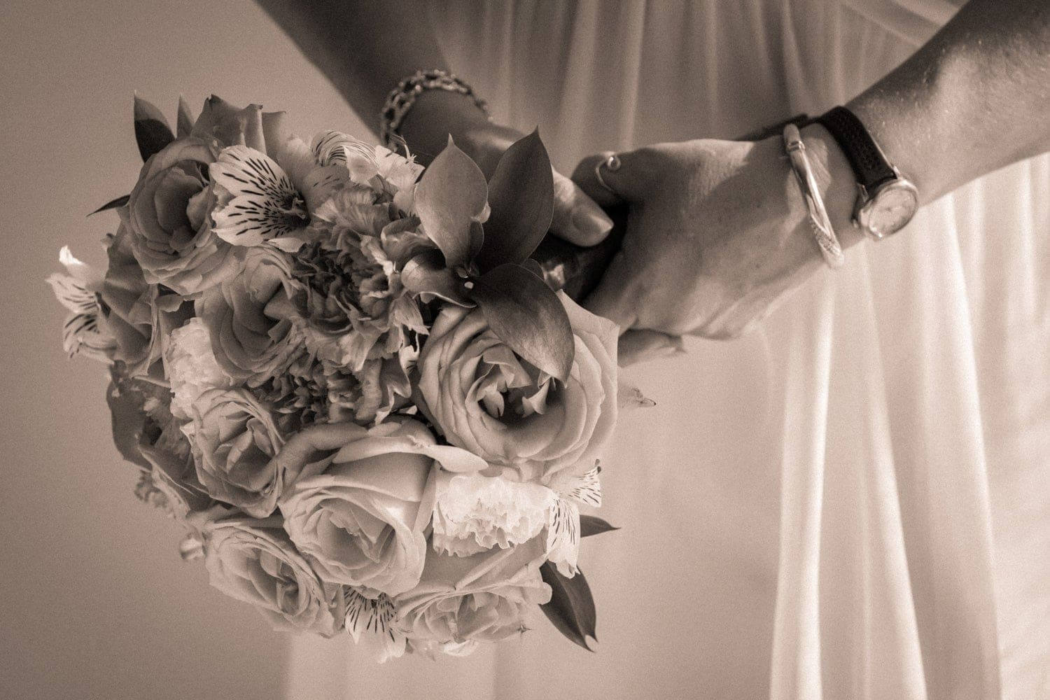 Bride holding gorgeous bouquet after preparing for her wedding in Costa Rica.