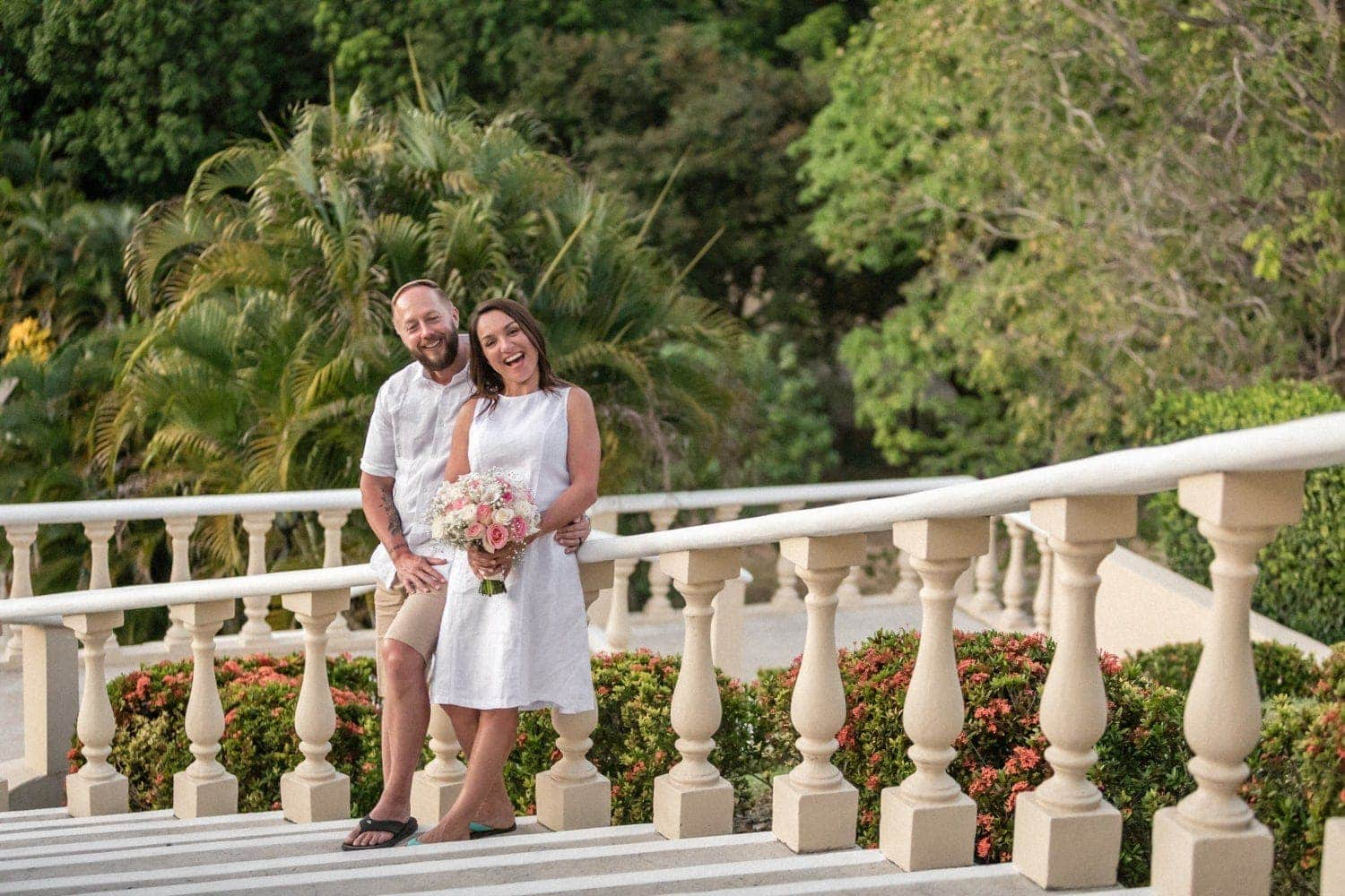 Photo of bride and groom on staircase at Occidental Papagayo Resort in Costa Rica.