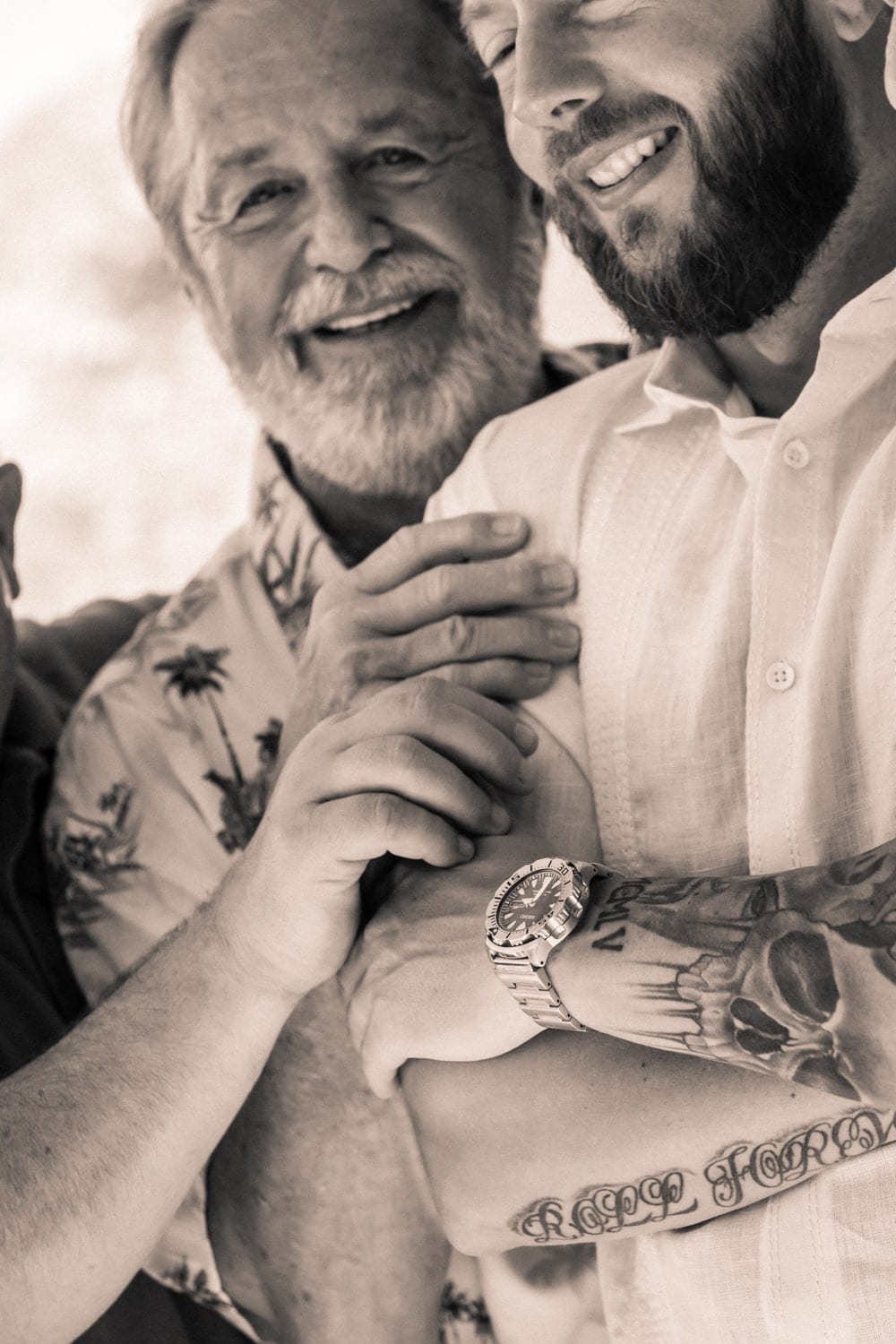 Father embraces son before his wedding ceremony at Occidental Papagayo Resort.