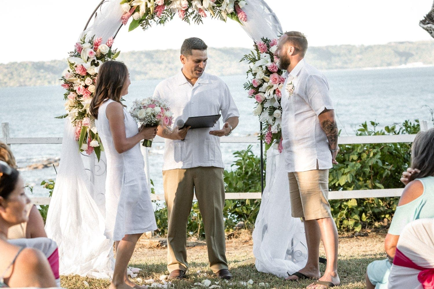 Wedding ceremony at Occidental Papagayo on hill overlooking ocean.
