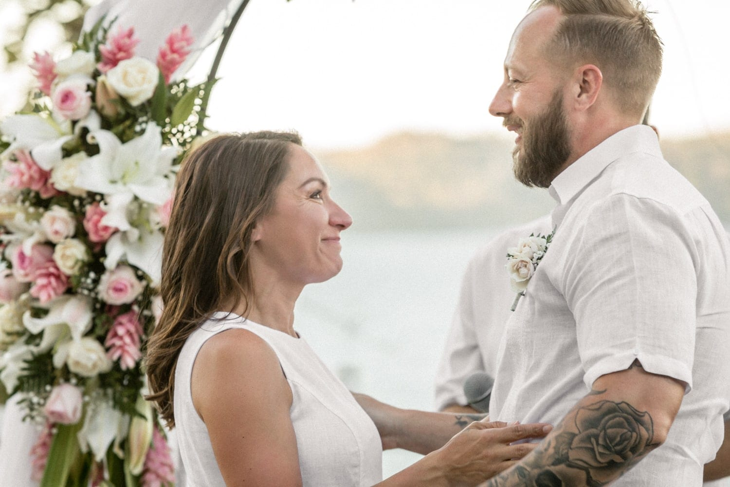 Great photo of couple getting married on hill with great ocean views.