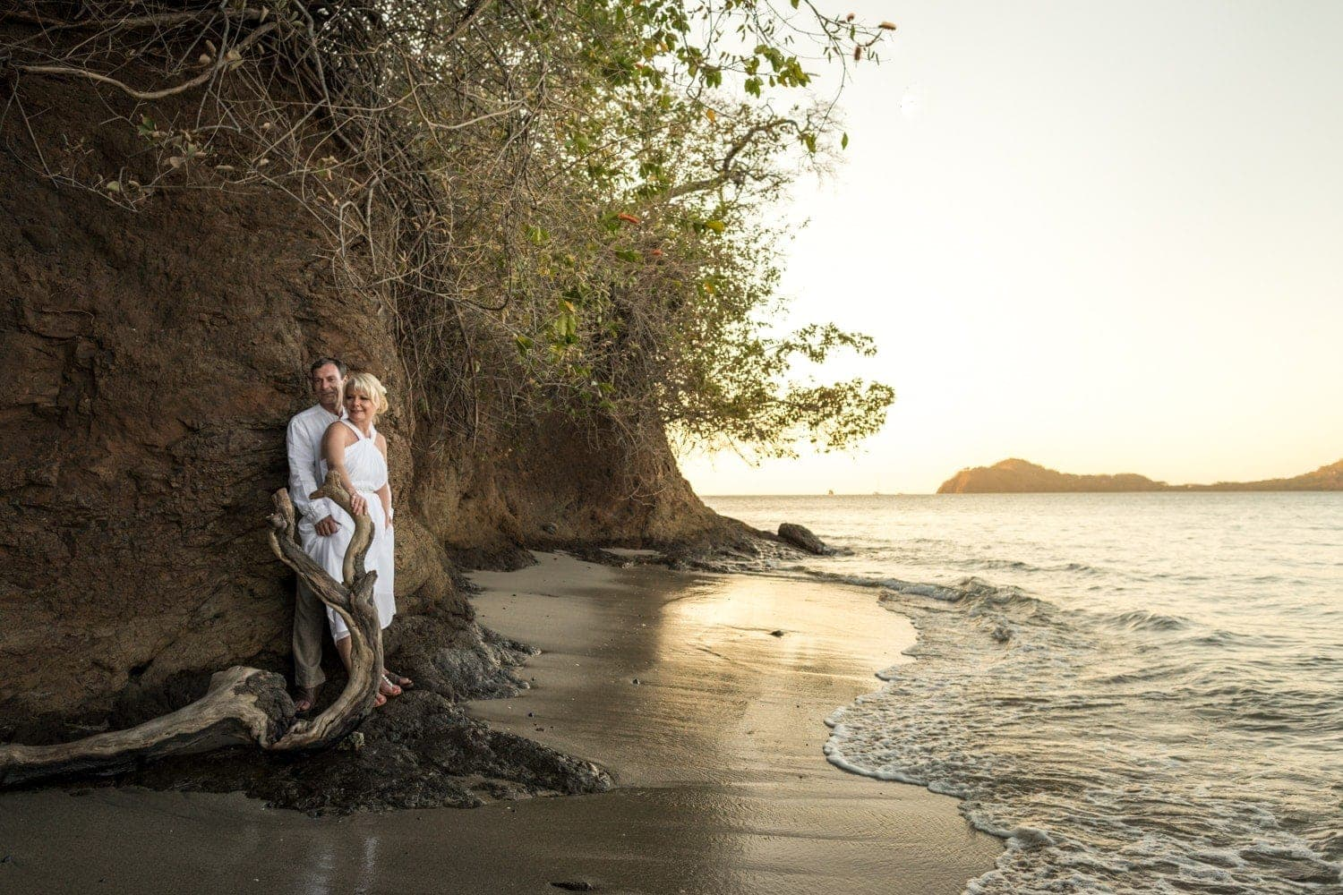 Photo of bride and groom on beach in Costa  Rica at sunset.