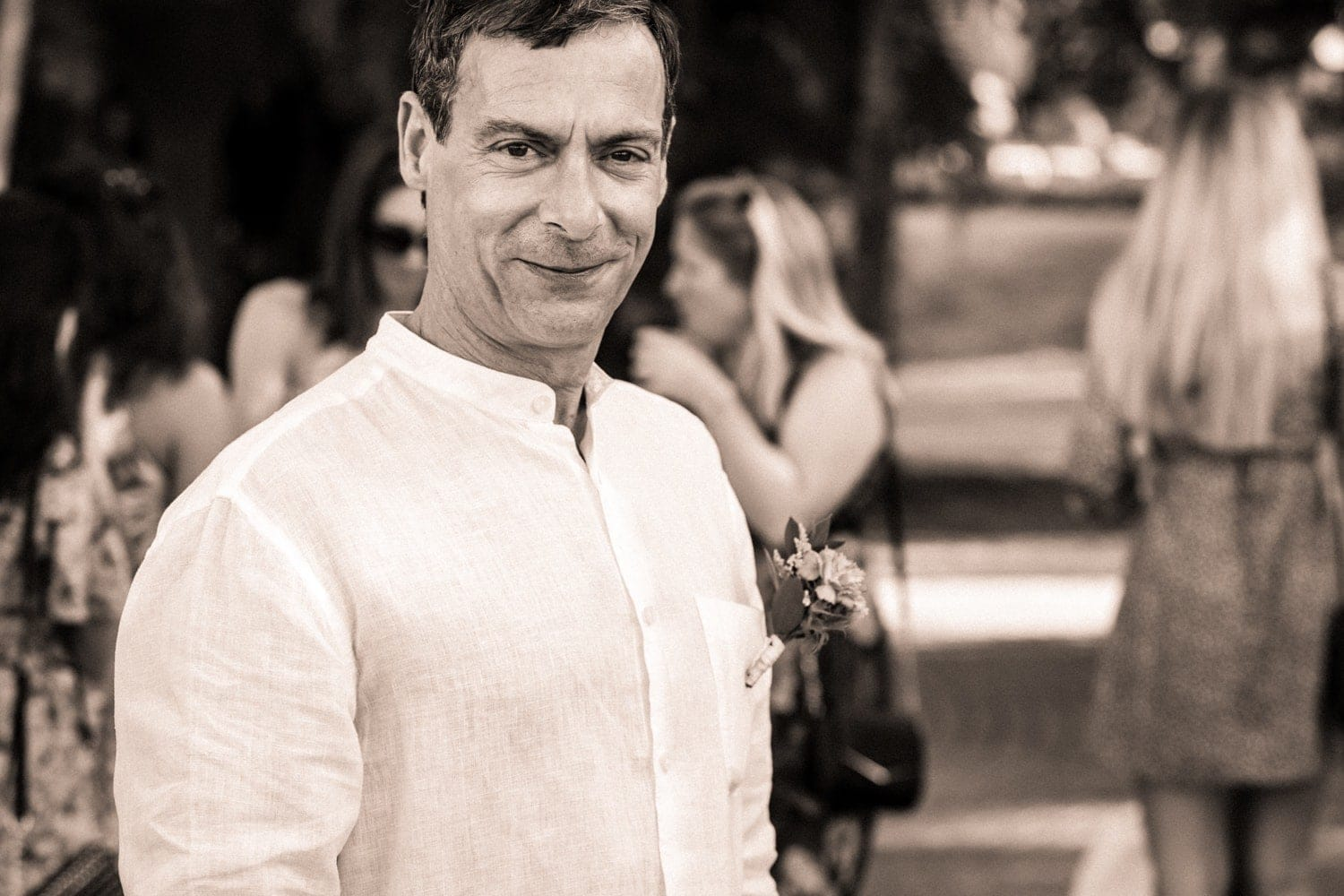 Black and white photo of groom waiting for bride.