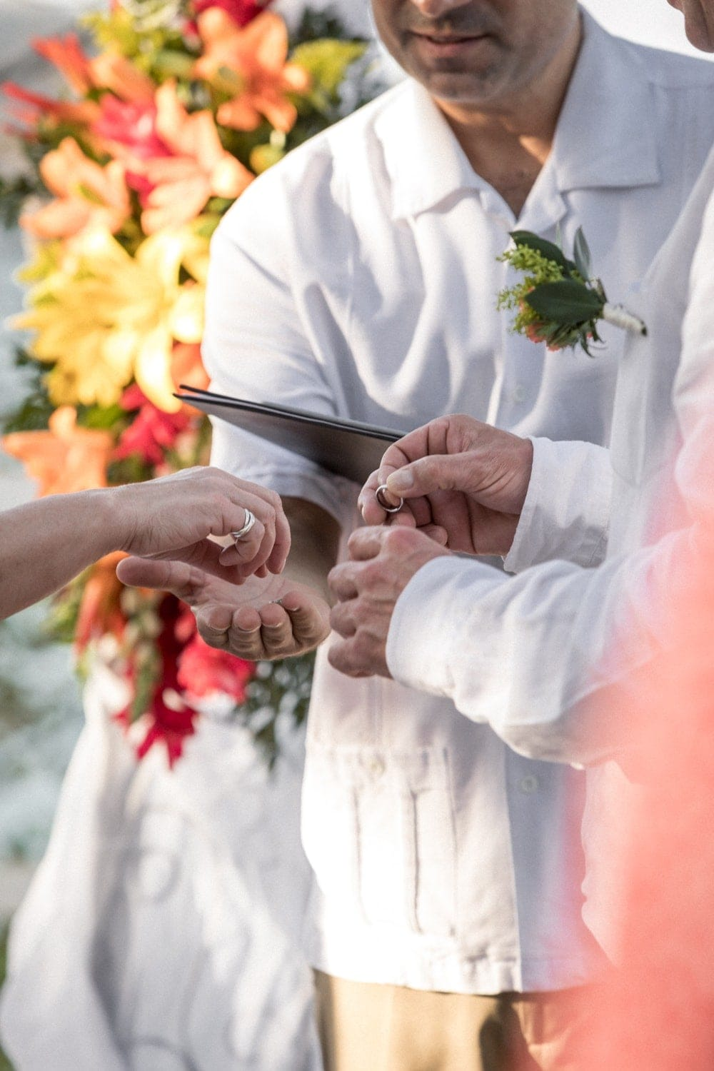 Exchanging or wedding bands during ceremony in Costa Rica.
