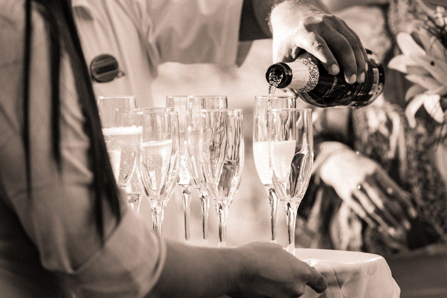 Pouring champagne for post-wedding ceremony toast.