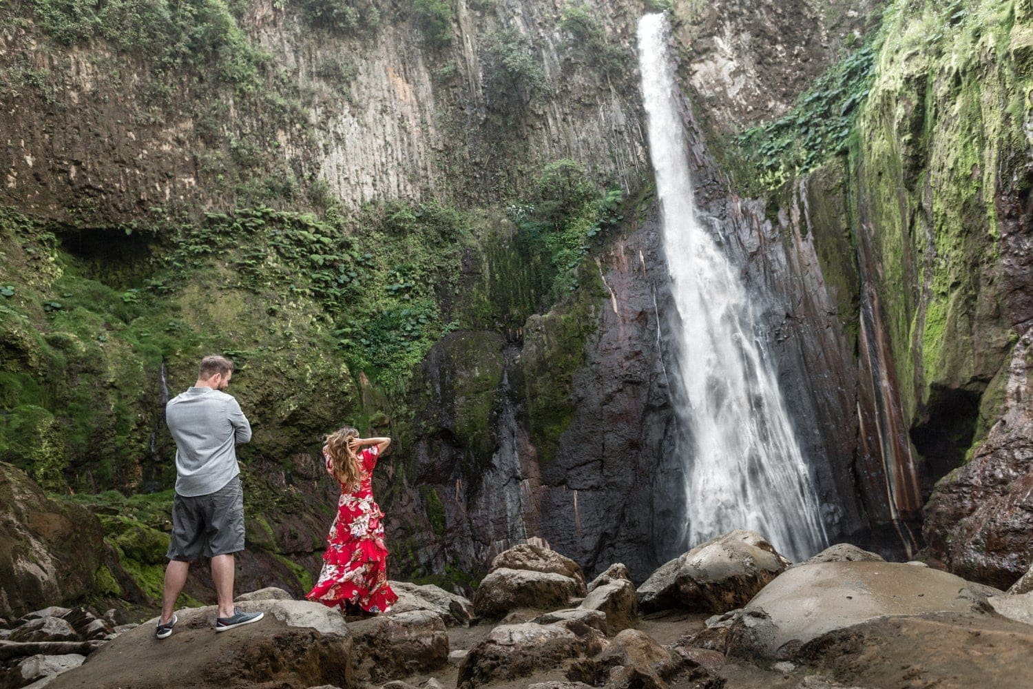 Photo of couple during Costa Rica waterfall engagement photo session.