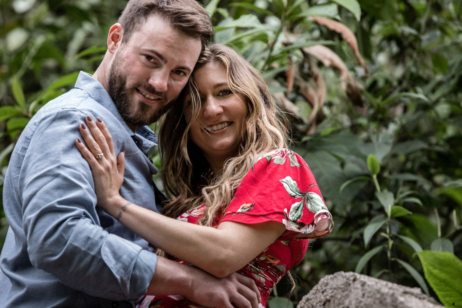 Happy couple smiling after getting engaged in Costa Rica.