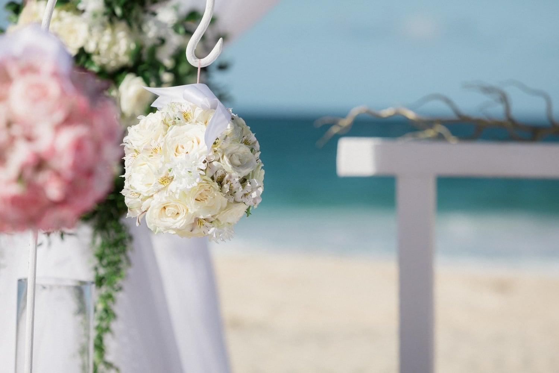 Gorgeous floral arrangements decorate beach wedding ceremony location at Hard Rock Resort, Punta Cana.