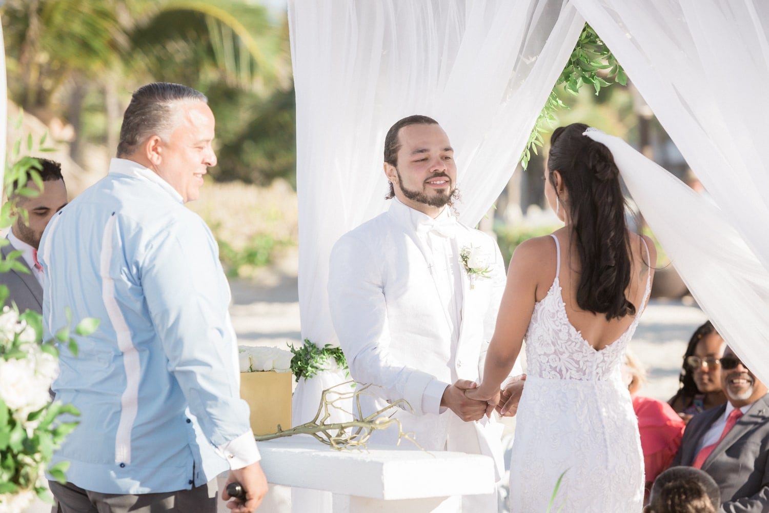 Couple saying their vows during marriage ceremony at Hard Rock Resort, Punta Cana.