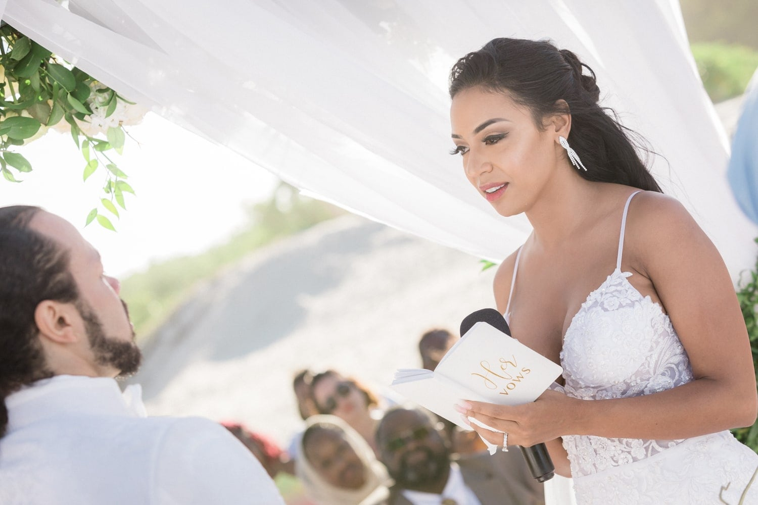 Bride says her vows at gorgeous wedding venue at Hard Rock Resort, Punta Cana.