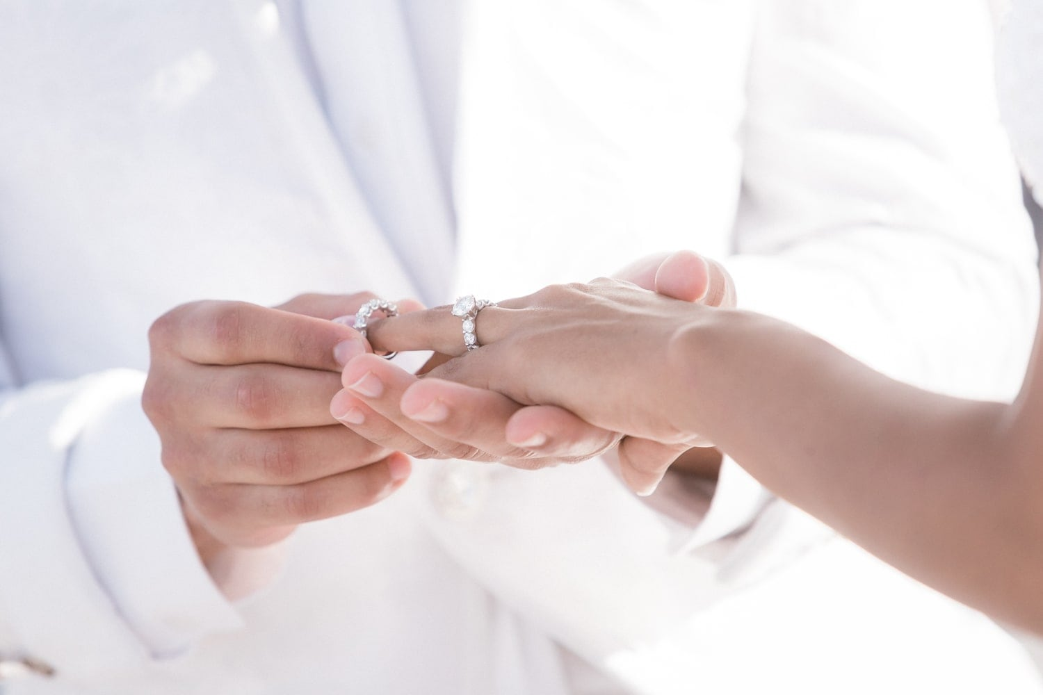Bride and groom exchange rings during ceremony at Hard Rock Resort, Dominican Republic.
