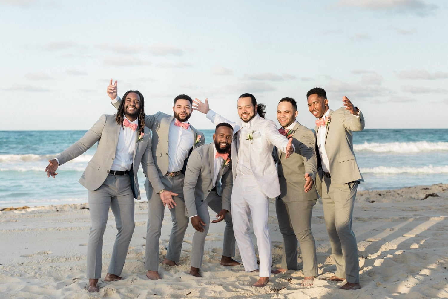 Groom and groomsmen pose for photo on gorgeous beach in Punta Cana.