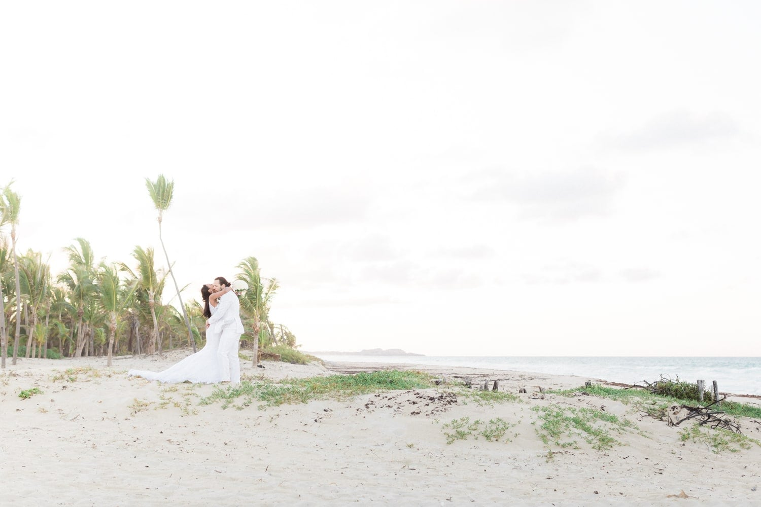 Environmental photos of just married couple on gorgeous beach in Punta Cana.