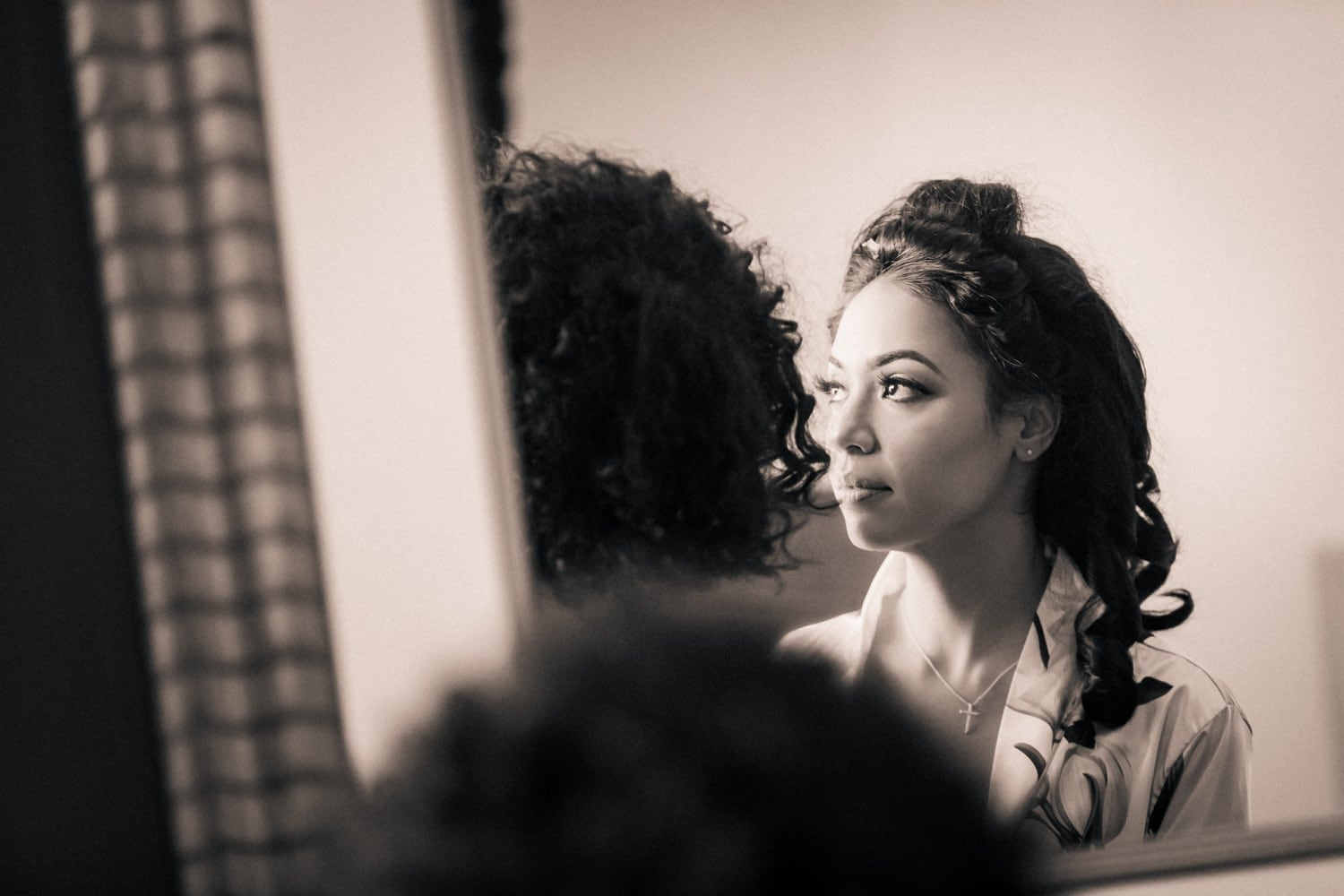Photo of reflection of bride preparing for wedding in Punta Cana, Dominican Republic.