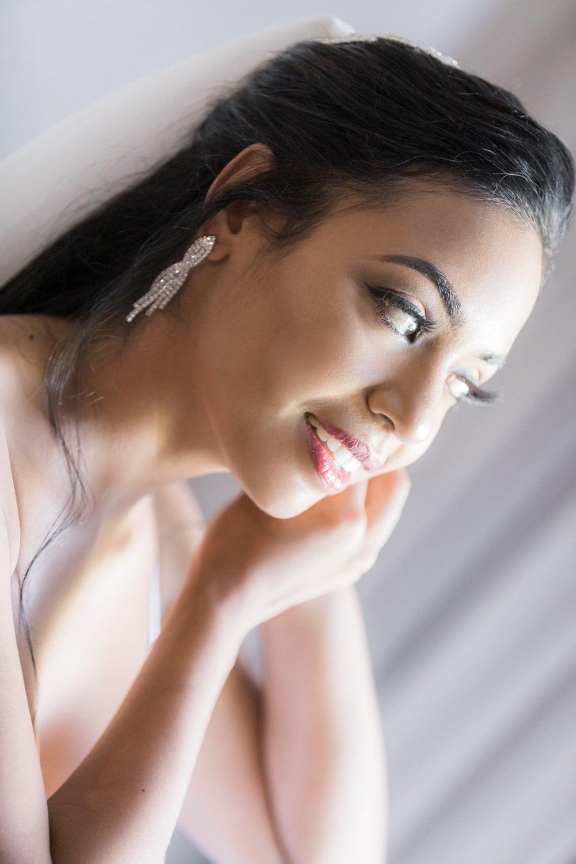 Bride preparing for her wedding ceremony in bridal suite.