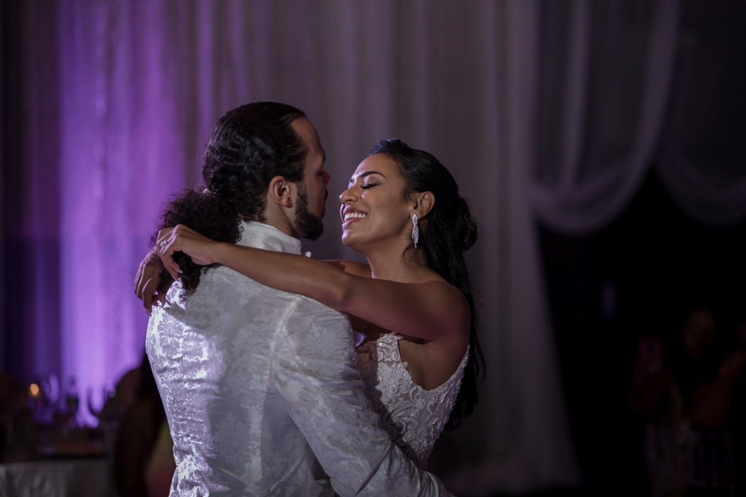 Gorgeous bride smiles during first dance at Hard Rock Resort, Dominican Republic.