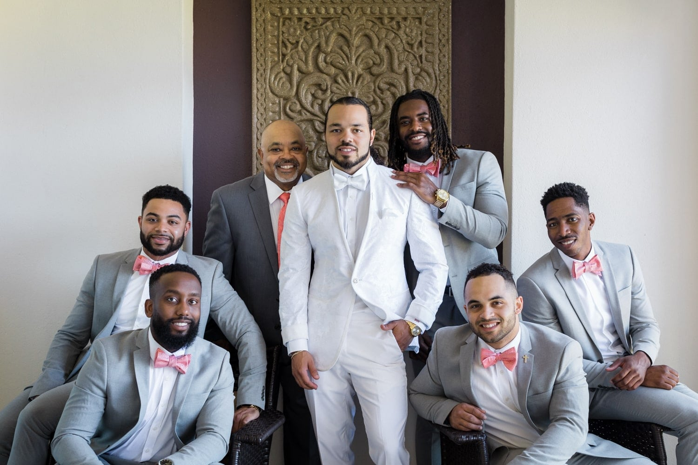 Photo of groom and groomsmen on balcony at Hard Rock Resort, Punta Cana.