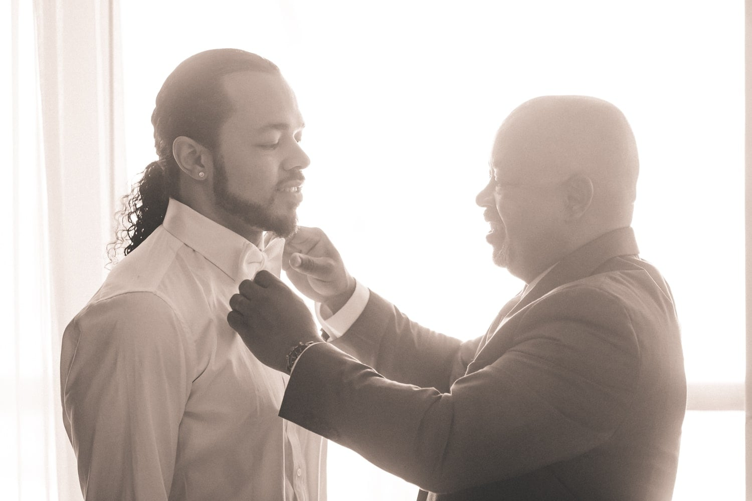 Father fixing son's bowtie just before his wedding at Hard Rock Resort in Punta Cana.