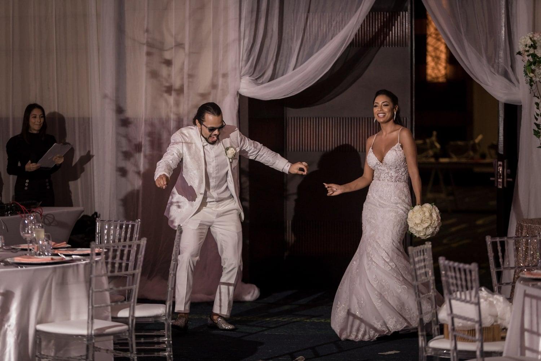 Just married couple make a splash entering Hard Rock Resort salon for wedding receptions.
