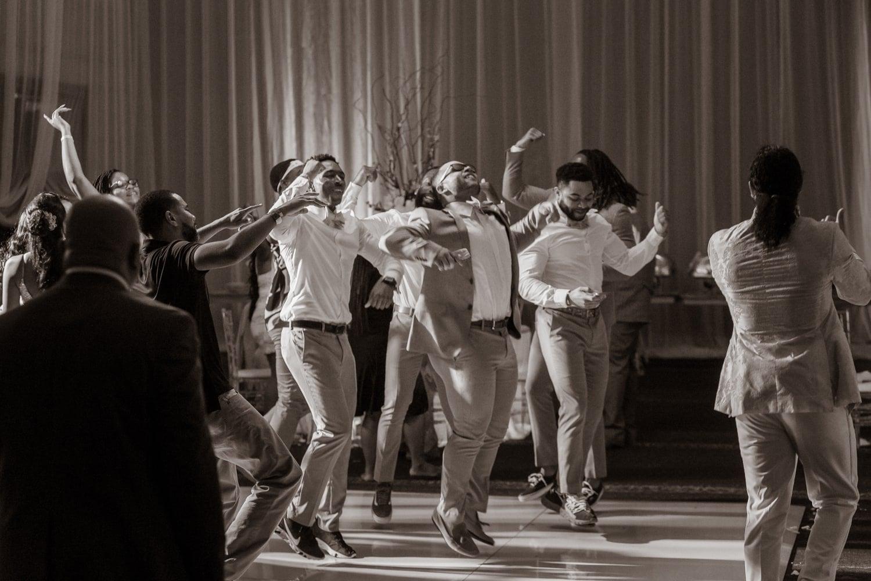 Groomsmen dancing at wedding reception in Punta Cana at the Hard Rock Resort.